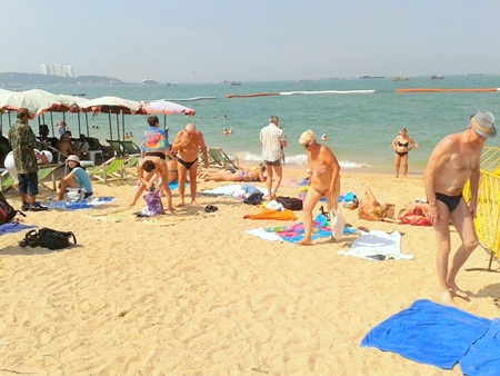 Tourists have begun to reclaim the beach, bringing their own mats and towels to lie on, as shown here at the beach by Central Pattaya t-junction.