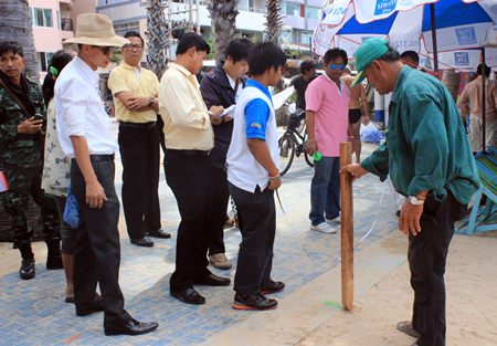 Pattaya and military officials begin staking out new zones for beach chairs and umbrellas on Pattaya Beach.