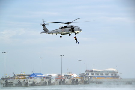 A helicopter from Naval Base 1 demonstrates how to rescue people at sea.