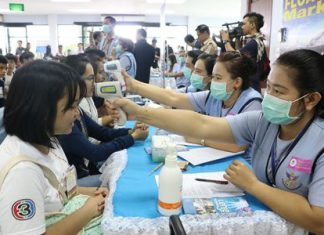 Health workers practice an emergency response in case airline passengers infected with Ebola are redirected to U-Tapao-Pattaya International Airport.