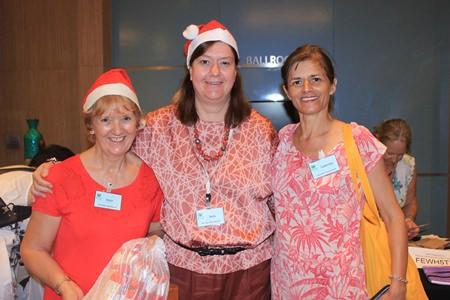 (L to R) Joyce Aldridge, Helle Rantsen, and Catherine Bollee from PILC can do a little Christmas shopping in between helping to run the bazaar.