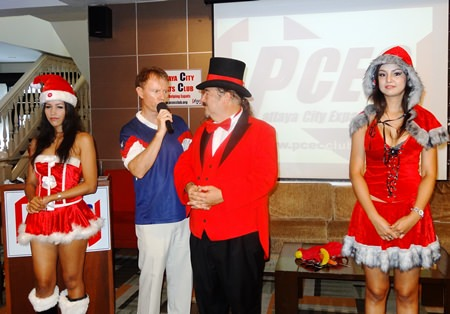 """MC Ren Lexander welcomes well known magician and mentalist, Doc Penguino, and his two beautiful assistants, """"Miss Distraction"""" and """"Miss Direction"""" to the Sunday, December 5, PCEC meeting."""