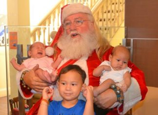 Santa has time for some younger members of the PCEC audience.