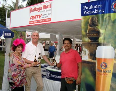 Elfi Seitz, Brendan Daly and Tony Malhotra seen enjoying Paulaner beer at the Pattaya Mail booth.