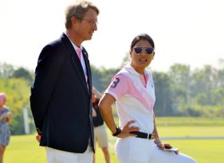 HRH Princess Sirivannavari Nariratana (right) talks with Harold Link, chairman of the B. Grimm Group, while watching the equestrian event.