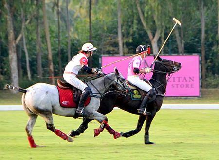 Paisano Dragons and Maple Leafs are shown in action at the Pink Polo charity event held at the Thai Polo and Equestrian Club in Pattaya on Sunday, December 14.
