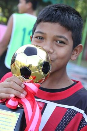 It may not be the winner's trophy, but he is still happy.