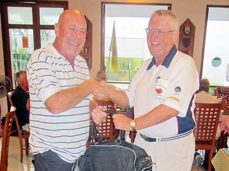 Dick Warberg (right) presents the MBMG Group Golfer of the Month award to Mike O'Brien.
