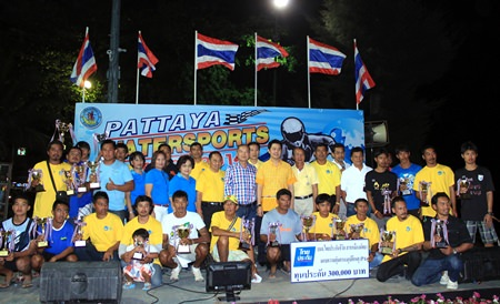 Winners and runners-up pose with their trophies at the conclusion of the 10th annual Pattaya Water Sports Festival at Jomtien Beach on December 19.