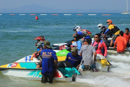 Jet-ski racers line up on the beach before the start of another heat.