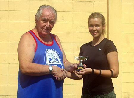 Dasha is presented with The President's Cup by Eric Hearn.