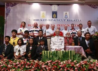 His Excellency Admiral M.L. Usni Pramoj, His Majesty the King's Personal Representative (centre), poses with individual champions and winning teams during the trophy presentation at this year's Phuket King's Cup Regatta.