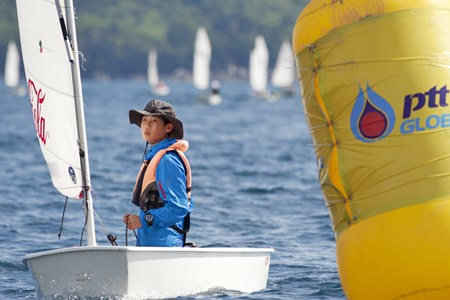 A young sailor competes in the Optimist dinghy class. (Photo by Guy Nowell)
