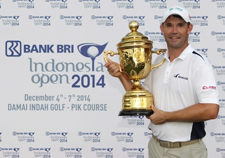 Padraig Harrington holds the champions trophy after winning the 2014 BANK BRI Indonesia Open at the Damai Indah Golf, PIK Course in Jakarta, Sunday, Dec. 7.