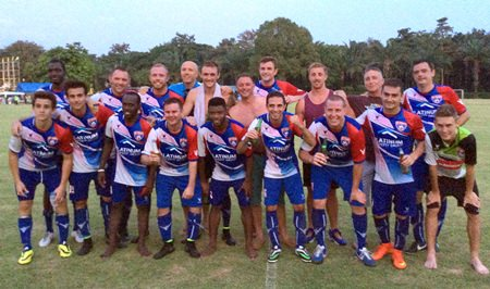 FC Planet players pose for a photo after their Bangkok Casuals 1st Division encounter with Brass Monkey FC at Horseshoe Point.