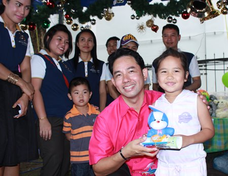 Mayor Itthiphol Kunplome is on hand to hand out presents to children.