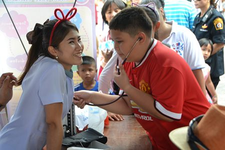 A young man plays doctor for a day courtesy of staff from the new Pattaya Hospital.