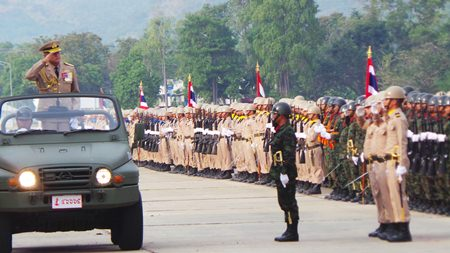 Adm. Kraisorn Chansuvanich inspects the troops on this year's Royal Thai Armed Forces Day.