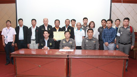(Seated, L to R) Mayor Itthiphol Kunplome, Pol. Col. Pisit Proirungrot, deputy commander of Chonburi Provincial Police (acting for the commander of Chonburi Provincial Police), and Pol. Col. Sukthat Pumpunmuang, superintendent of Pattaya Police Station, co-sign the agreement.