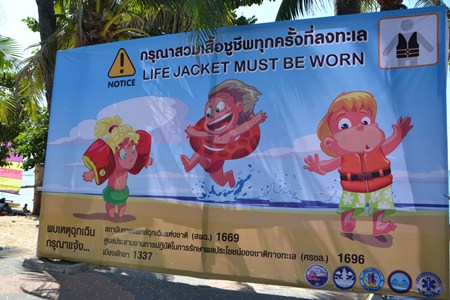Hoping to prevent deadly accidents at the beach, Pattaya has installed warning signs telling parents to be sure their children wear life vests.