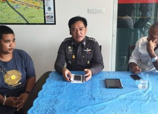 Pol. Col. Supathee Bunkhrong (centre) interrogates jet ski vendor Chawalit Janthong who was arrested for assaulting a Swedish tourist who intervened in the vendor's alleged extortion of a customer.