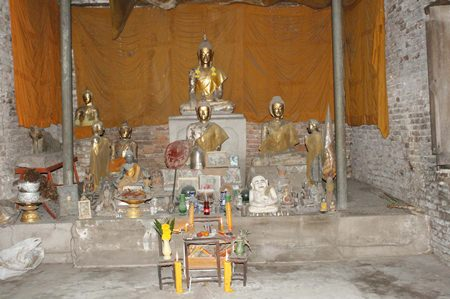 Buddha statues and other artifacts remain inside the ancient temple.