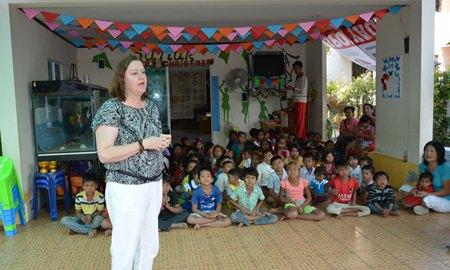 PILC President Helle Rantsen explains what the Sanuk Day Care Center does for local children.