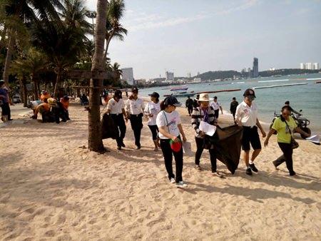 Police volunteers and friends grab garbage bags and help keep the beach clean.