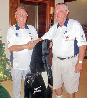 Dick Warberg (right) is presented with the MBMG Group Golfer of The Year award by Derek Brook.