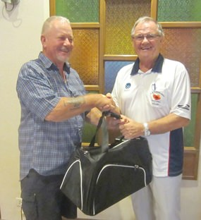 Barry Elphick (left) receives the MBMG Group Golfer of The Month award for December.