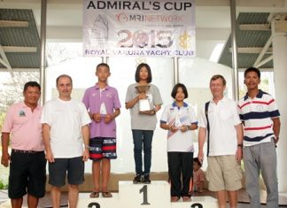 13-year old Intira Parnpiboon stands atop the podium with the Admiral's Cup flanked by Chanakchon Wangsuk and Suchakree Detthoappol, who came 2nd and 3rd respectively in the Optimist division. Also in picture are Mark Hamil-Stewart, Vice Commodore (2nd left), Chris Dando, Rear Commodore (2nd right) and Nattawut Vongrak - Kru Oat, Opti Coach from RVYC (far right), along with Kru Somkiat Poonpat, Thailand National Opti Coach (far left)