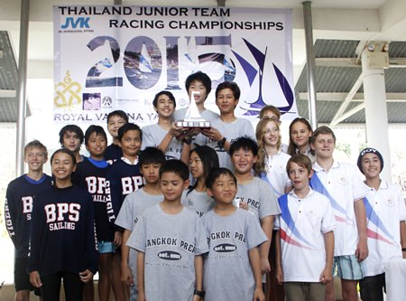 Junior sailors from Bangkok Prep. School stand atop the podium with the trophy as the teams from Bangkok Patana School (left) and Lycée Français (right) look on.
