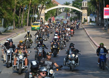 A caravan of over 100 big bikes rumbles down North Road onto Beach Road near the beginning of their Ride for Peace through Pattaya.  The event kicked off the annual Burapa Bike Week promoting friendship and parties.