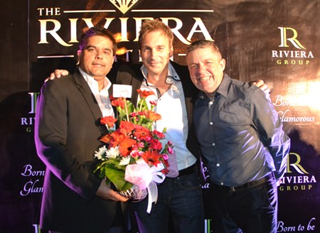 (L to R) Tony Malhotra, Deputy MD of the Pattaya Mail Media Group, congratulates Winston Gale of Riviera Group, with Paul Strachan, Production Manager of PMTV.