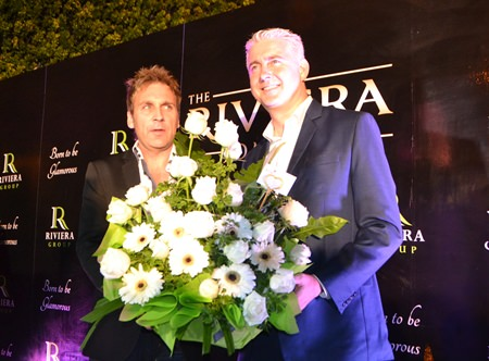 Brendan Daly (right), General Manager of the Amari Pattaya presents flowers and congratulates Winston Gale (left) of the Riviera Group on the grand opening of the new showroom.