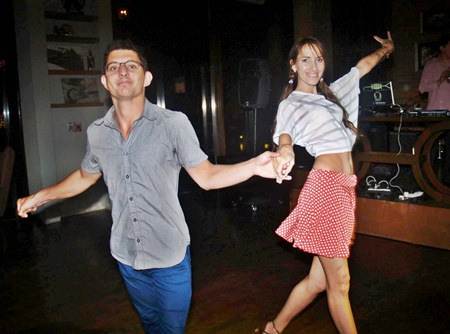 Couples salsa the night away at the Red & White Valentines Party hosted by Holiday Inn's Havana Bar.