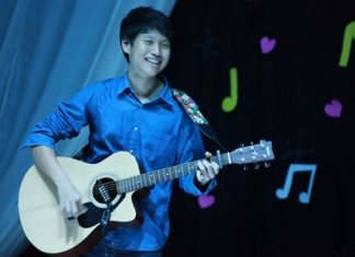 A Year 11 student plays guitar during the talent show.