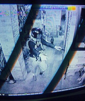 This still image taken from the security video camera allegedly shows Ayder Bezaziyev holding up the currency exchange shop.