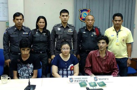 Adil Hueeani, his wife Surayya and one of their children are shown during the press briefing announcing their arrest.
