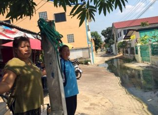 City officials have promised to send a send a truck out to pump this polluted water out of a Soi Arunothai neighborhood.