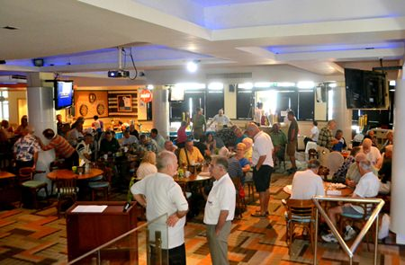 PCEC members and guests enjoy visiting with each other in the Amari's Tavern by the Sea Restaurant pending the start of the club's Sunday program.