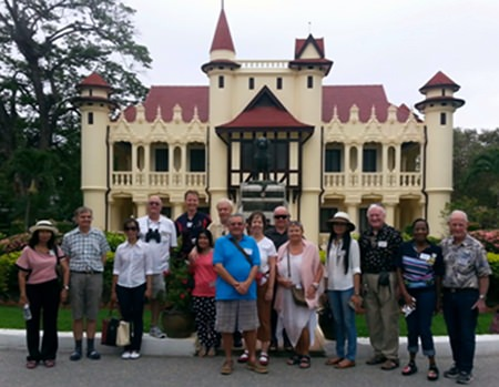 Members of the tour group to Nakhon Pathom Province pose before the Chali Mongkol Asana, a building on the grounds of the Sanam Chandra Palace.