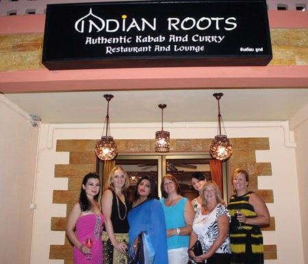 Bobby (3rd left) proudly poses with friends at the entrance to Indian Roots.