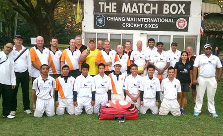 Pattaya Cricket Club players pose with the Lanna C.C. team at the Gymkhana ground in Chiang Mai, Feb. 15.