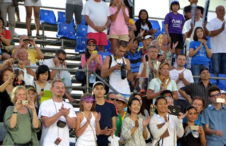 Spectators applaud both players at the end of a pulsating singles final.