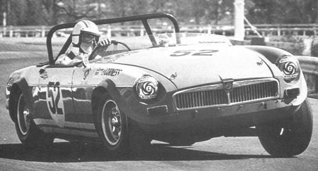 Dr Iain Corness drives his race-modified MGB in this undated photo.