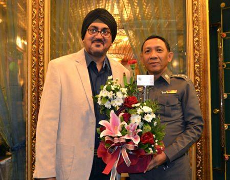 Deputy Commander of Trat Provincial Police, Pol. Col. Sujin Meekajit congratulates Naini Grover.