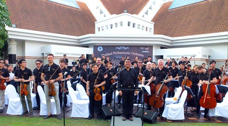 Conductor Lt. Col. Prateep Suphanrojn (centre) poses with the Thailand Philharmonic Orchestra at the Phornprapha Botanic Gardens in Pattaya.