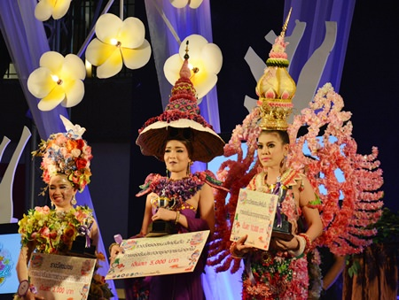 Winners in the flowered dress contest add pulchritude and fragrance to the show.