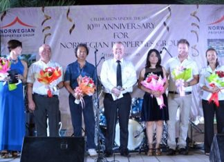 (L to R) Managing partner Jeanette E. Heltne, managing partner Jan Trandal Hakon, General Manager Kanit Bunnason, Managing Director Gudmund Eiksund, Accounting Manager Napak, managing partner Ronny Heltne, and Chollada Cheewapreecha take a bow for accomplishing 10 years of hard work.